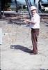 "Williard (""Bill"") Shrives helps install wig-wag signal, 5/1989 acc2005.001.1187"