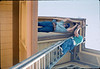 M&M Construction installs new redwood gutters, 5/1988. acc2005.001.0981