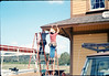 M&M Construction installs new redwood gutters, 5/1988. acc2005.001.0967