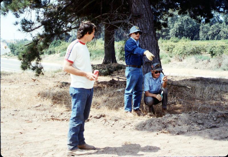Dan Larson, Roger Levenson, and Gene Allen help with the miniature-railroad track construction, 6/1987 acc2005.001.0821