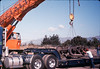 Caboose truck is lowered onto the awaiting truck trailer, 9/25/1986 acc2005.001.0623