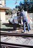 Gene Allen pours foundation for train-order pole from Santa Barbara station, 1/1987 acc2005.001.0677