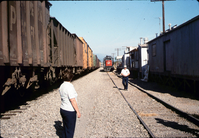 X7545 east-bound local delivers Caboose 4023 to La Patera spur (Harriett and Jack Cogan), 9/21/1986 acc2005.001.0606