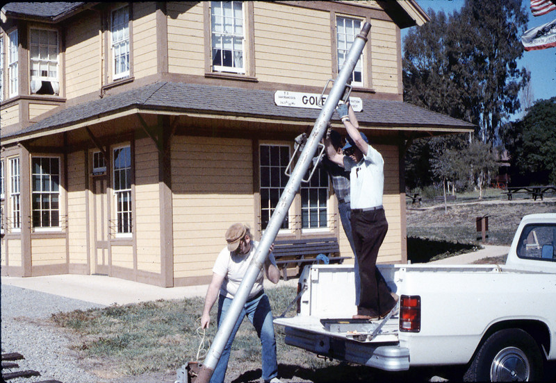 Gene Allen, Glen Apers and Glen's son install train-order post, 2/1987. acc2005.001.0688