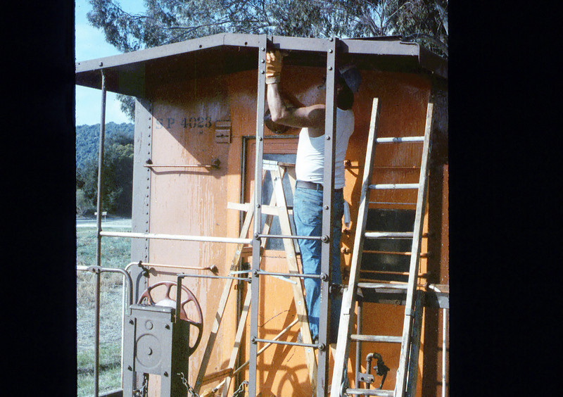 Ron Robinson cleans Caboose 4023, 12/1986 acc2005.001.0660