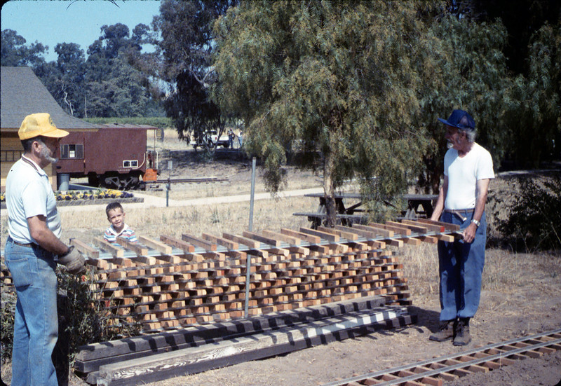 Gene Boswell and Malcolm Alexander help with the miniature-railroad track construction, 6/1987 acc2005.001.0807