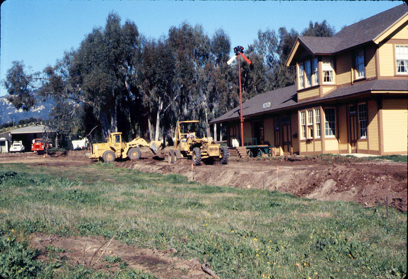 Banner Construction crew grades in preparation for standard-gauge track construction in front of Goleta Depot, 1/1985. acc2005.001.0467