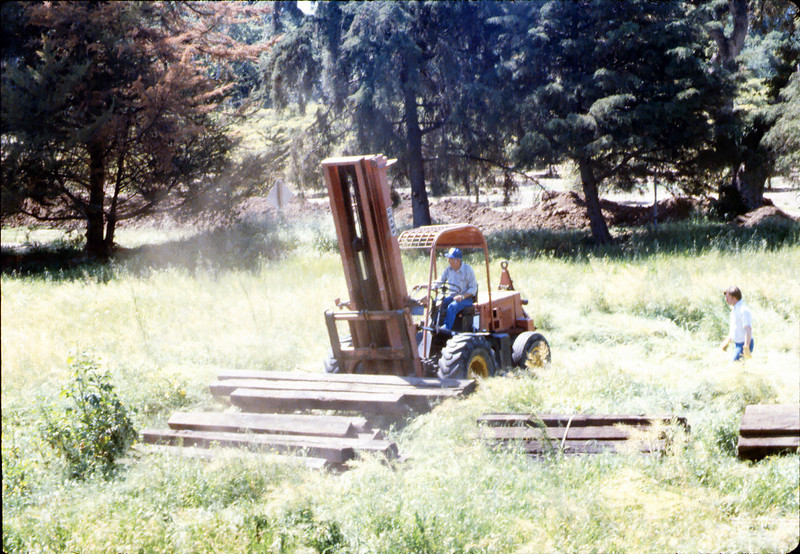 Laying of the standard-gauge track (Ed Lebeck on forklift; John Lebeck), 4/2/1985 acc2005.001.0480F