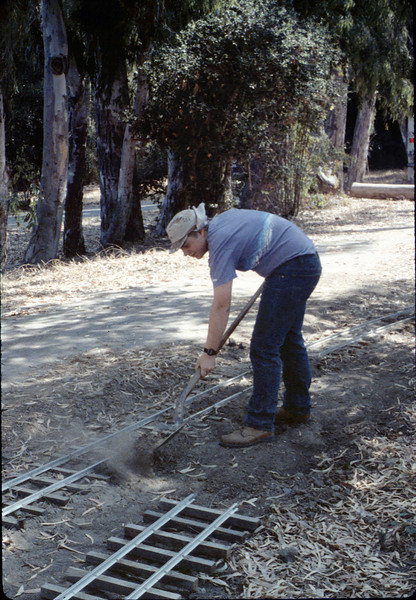 Scott Cogan helps with the miniature-railroad track construction, 6/1987 acc2005.001.0805
