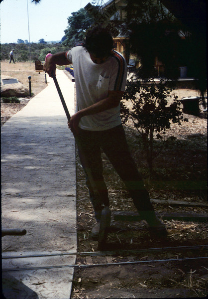 Dan Larson helps with the miniature-railroad track construction, 6/1987 acc2005.001.0823