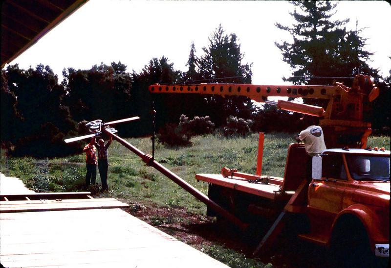Specialty Crane & Rigging truck raises train-order pole for re-installation (Bill Everett and Gene Allen are at left-center), 10/1983. acc2005.001.0423