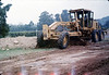Banner Construction grades right-of-way for miniature-train track, 10/1986. acc2005.001.0642