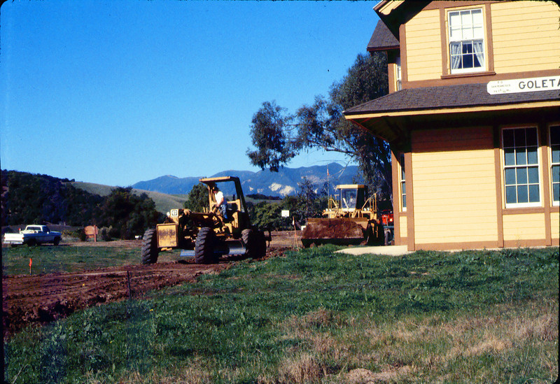 Banner Construction crew grades in preparation for standard-gauge track construction in front of Goleta Depot, 1/1985. acc2005.001.0468