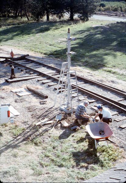 Gene Allen and Glen Apers install train-order post, 2/1987. acc2005.001.0694