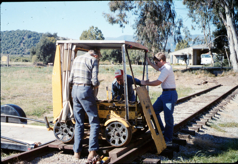"""Gene Allen, Ed Lebeck, and Warren Johnson, who donated this inspection car (""""speeder"""") to the museum, 1/17/1987 acc2005.001.0670"""