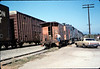 X7545 east-bound local delivers Caboose 4023 to La Patera spur, 9/21/1986 acc2005.001.0603