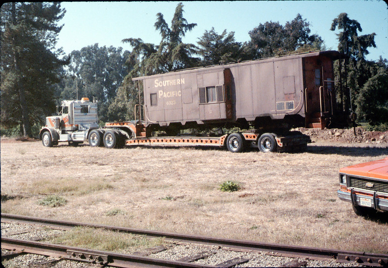 Caboose will soon be raised, then lowered onto the awaiting trucks, 9/25/1986 acc2005.001.0635