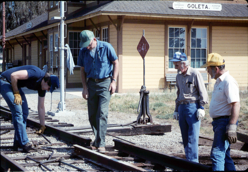 Track extension construction crew -- Ralph Moore, Gene Boswell, Malcolm Alexander, and Scott Moore, 4/18/1987. acc2005.001.0761