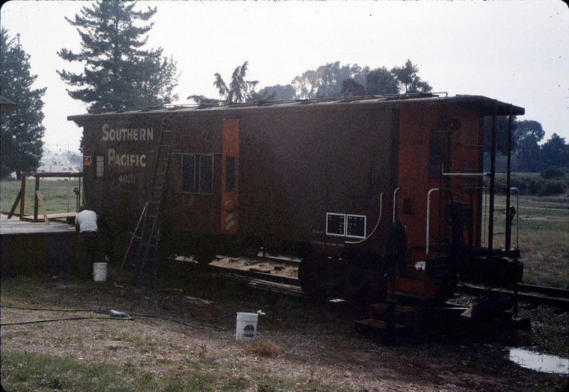 Ron Robinson cleans Caboose 4023, 12/1986 acc2005.001.0655