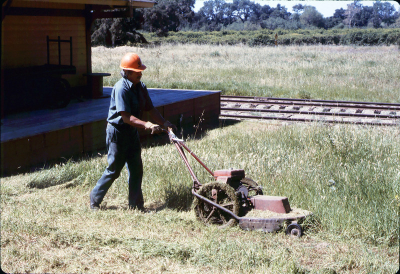 Al Jaramillo mows weeds around grounds, Spring 1986 (sic) acc2005.001.0679