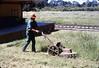 Al Jaramillo mows weeds around grounds, Spring 1986 (sic) acc2005.001.0679