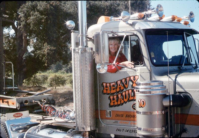Phyllis Olsen in Dennis Romero Heavy Hauling cab, 9/25/1986 acc2005.001.0631