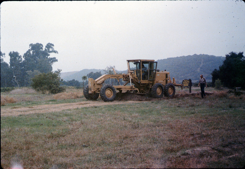 Banner Construction grades right-of-way for miniature-train track, 10/1986. acc2005.001.0641
