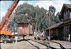 Crane raises caboose body while trucks wait on museum tracks, 9/25/1986 acc2005.001.0638
