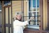 Phyllis Olsen washing windows, 4/181987 acc2005.001.0766