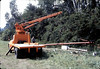 Specialty Crane & Rigging truck raises train-order pole for re-installation, 10/1983. acc2005.001.0422