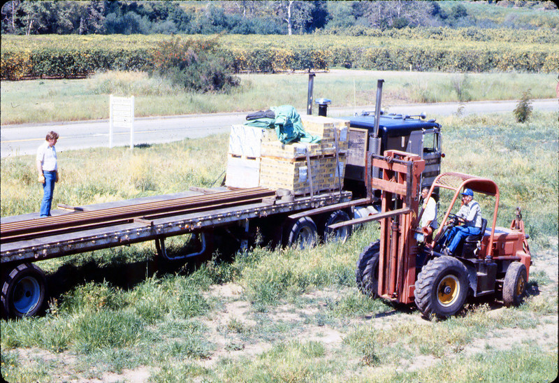 Laying of the standard-gauge track (Ed Lebeck on forklift; John Lebeck on truck), 4/2/1985 acc2005.001.0479