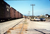 X7545 east-bound local delivers Caboose 4023 to La Patera spur, 9/21/1986 acc2005.001.0600