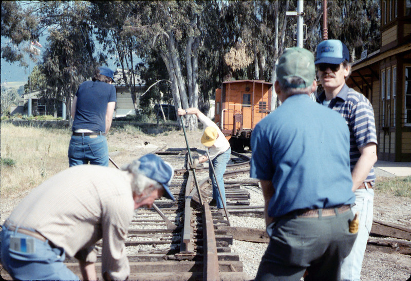 Track extension construction crew -- Ralph Moore, Gene Boswell, Malcolm Alexander, Scott Moore, and Perry Adams, 4/18/1987. acc2005.001.0748