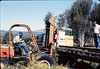 Laying of the standard-gauge track (Ed Lebeck on forklift; John Lebeck on truck), 4/2/1985 acc2005.001.0478