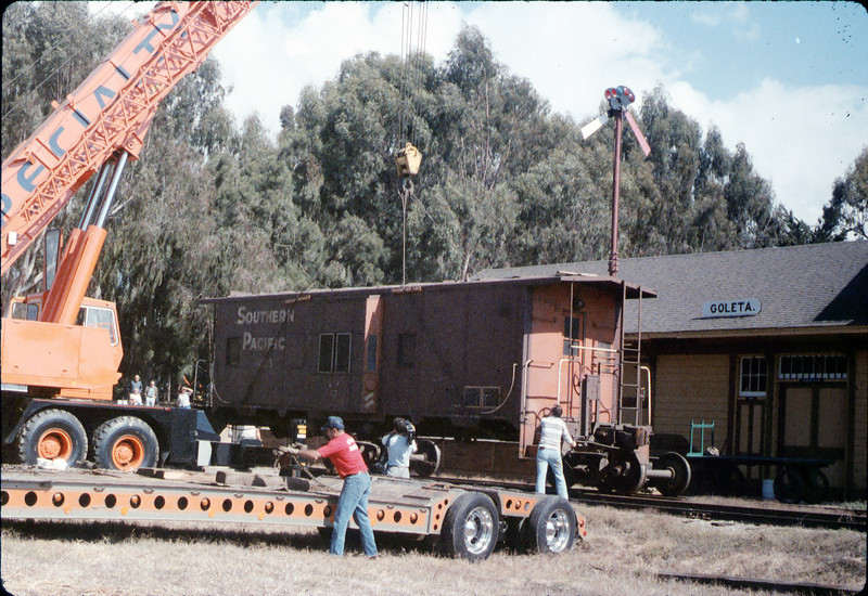 Crane lowers caboose body onto the waiting trucks, 9/25/1986 acc2005.001.0639