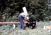 Gene Allen prepares train-order pole for re-installation, 10/1983. acc2005.001.0421