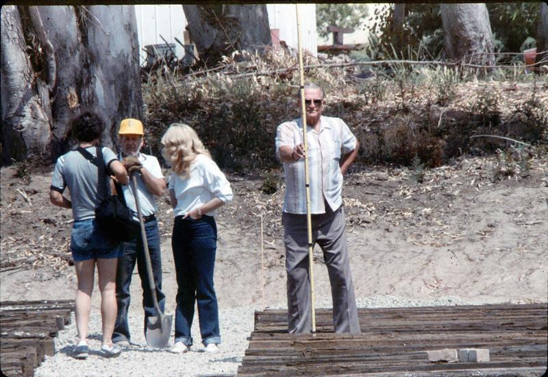 Laying of the standard-gauge track (Gene Boswell, Phyllis Olsen, Capt. Rodman), 5/11/1985. acc2005.001.0497