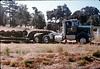 Caboose trucks are moved (Frank Marton Trucking) from La Patera to museum grounds, 9/25/1986 acc2005.001.0629