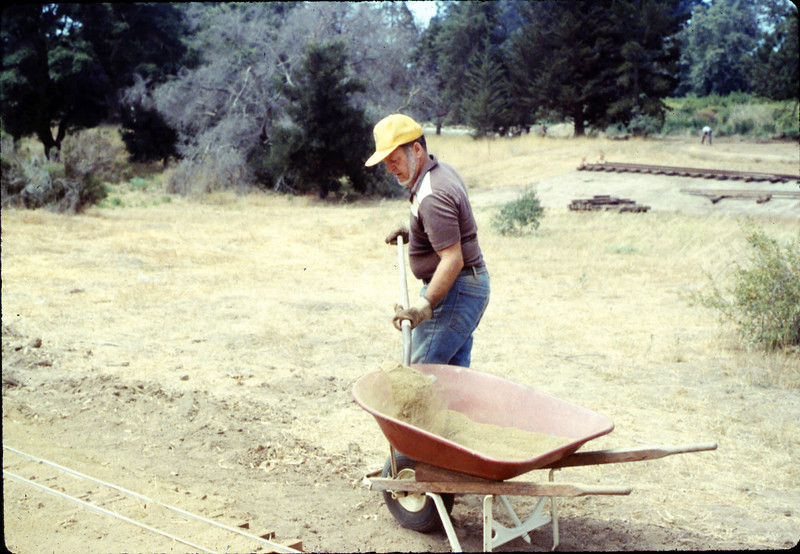 Gene Boswell helps with the miniature-railroad track construction, 6/1987 acc2005.001.0825
