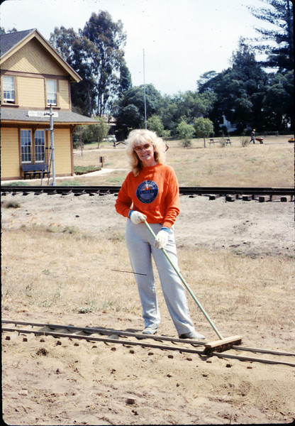 Phyllis Olsen helps with the miniature-railroad track construction, 6/1987 acc2005.001.0822