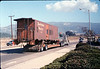 Caboose body is moved by truck from La Patera to museum grounds, 9/25/1986 acc2005.001.0627