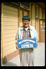 """Les The Sign Man"" shows replica Wells Fargo sign he painted, 1991. acc2005.001.1507"