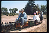 Wedding party rides the miniature train during Steaming Summer, 1991. acc2005.001.1484