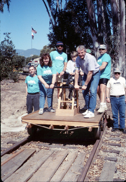 "Taken during the museum's ""Asphalt Regatta"" spring fundraiser (County Supervisor Tom Rogers & handcar volunteers), 3/17/1990.  If this handcar photo is your favorite, click on the ""ADD COMMENT"" button at the lower left to tell us why you like this particular photo. Please include your name and contact information (Parental approval is required if you are under age 18).acc2005.001.1302"