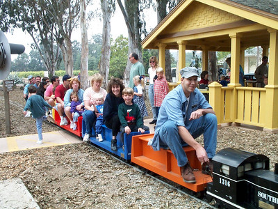 """On this trip, the miniature train is filled with passengers.  If this photo is your favorite, click on the """"ADD COMMENT"""" button at the lower left to tell us why you like this particular photo. Please include your name and contact information (Parental approval is required if you are under age 18)."""