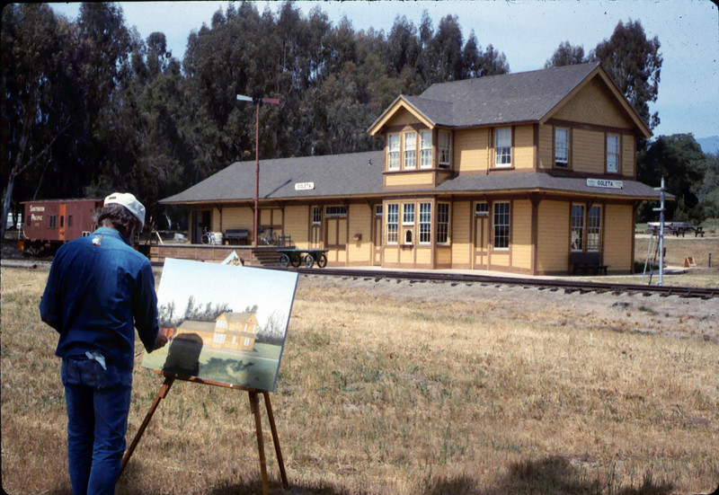 "Artist captures Goleta Depot's essence, May 1987. Do you know who he is?  If you can help,  use the ""ADD COMMENTS"" button in the lower left to tell us. Please include your name and contact information. acc2005.001.0792"