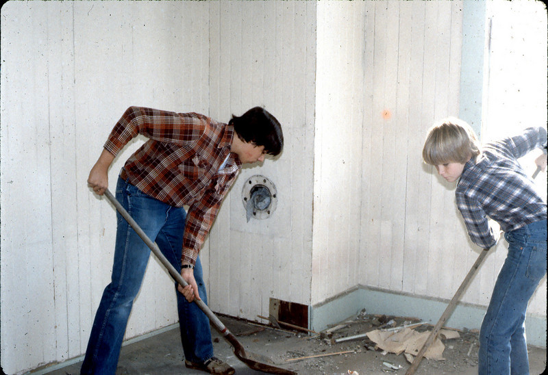 "Volunteers from Goleta Valley Junior High School help with building cleanup, Feb. 1982. Do you know who they are? If you can help,  use the ""ADD COMMENTS"" button in the lower left to tell us. Please include your name and contact information. acc2005.001.0144"