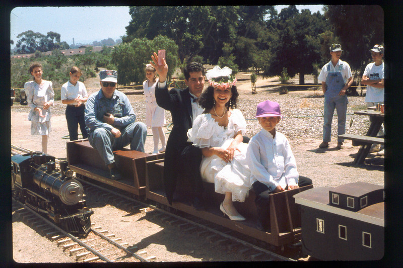 "Wedding party rides the miniature train during Steaming Summer, 1991. Can you identify anyone in this photo? If you can help,  use the ""ADD COMMENTS"" button in the lower left to tell us. Please include your name and contact information. acc2005.001.1482"
