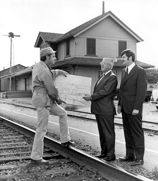 """We know this photo was taken in the 1960s or early 1970s. We also think that the photo might have something to do with """"Mission Federal Savings & Loan."""" Can you identify these men, or fill us in on what they are doing?  If you know, use the """"ADD COMMENTS"""" button in the lower left to tell us. Please include your name and contact information."""