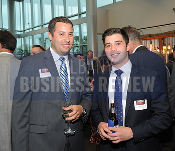 6-18-2015, Albany Business Review's Book of Lists bash. Jeff Trudeau of Saratoga National Bank & Trust with Kevin Baker of Schwartz Heslin Group.